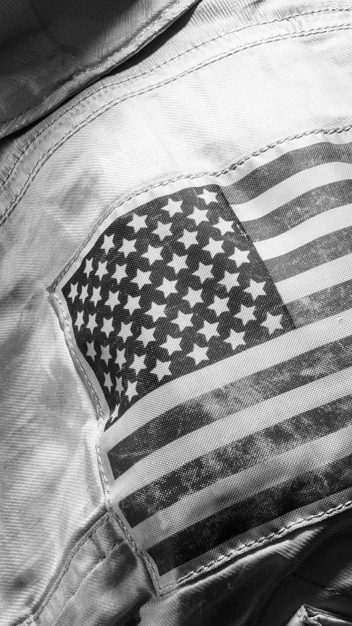 The American flag patch on the arm of a space suit.