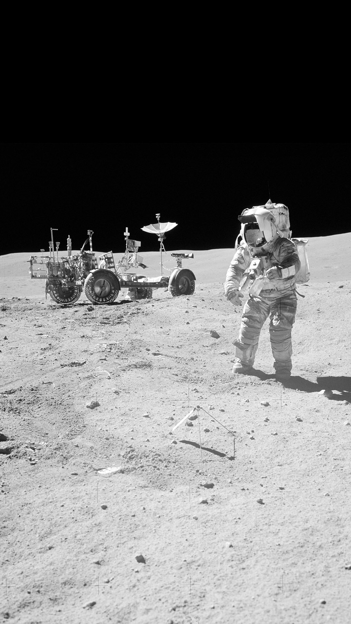 An astronaut and equipment on the surface of the moon.