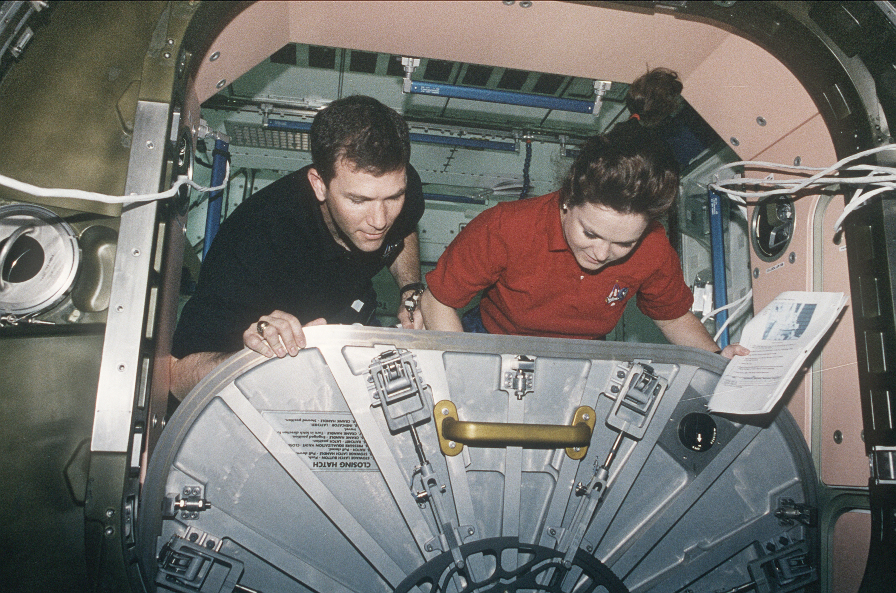 STS-96 Astronauts Adjust ISS Unity Hatch