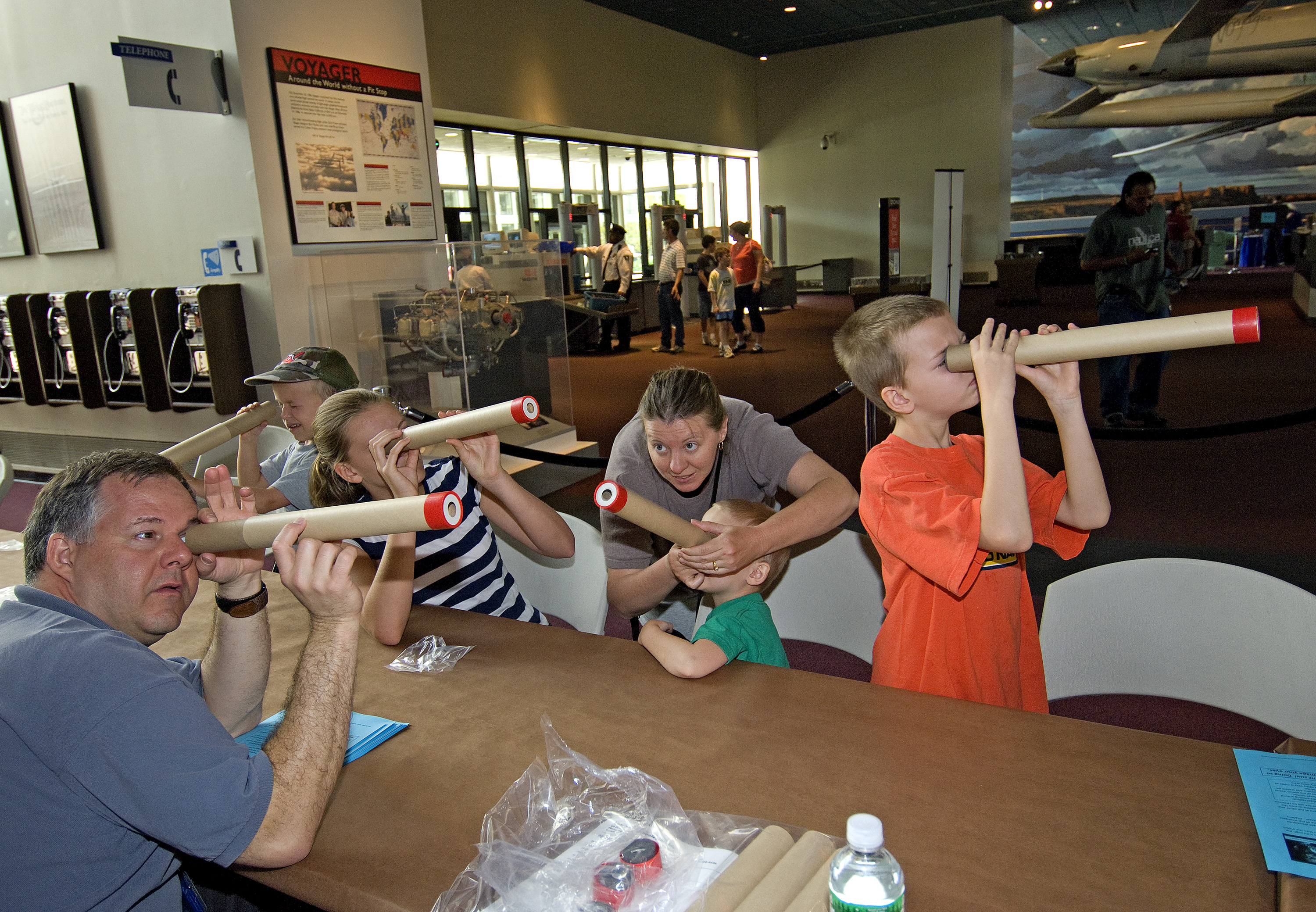 Visitors Look Through Telescopes at Explore the Universe Day
