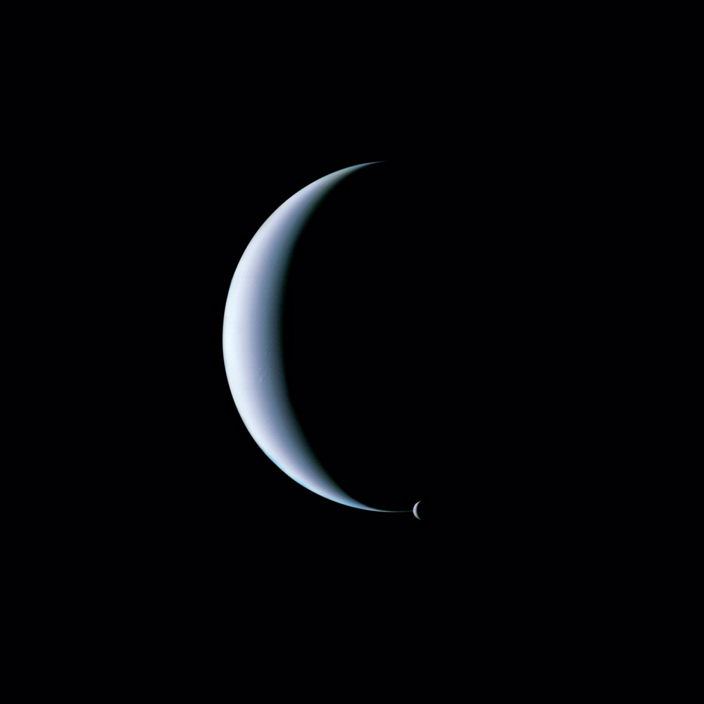 Dual crescent view of Neptune and its moon Triton