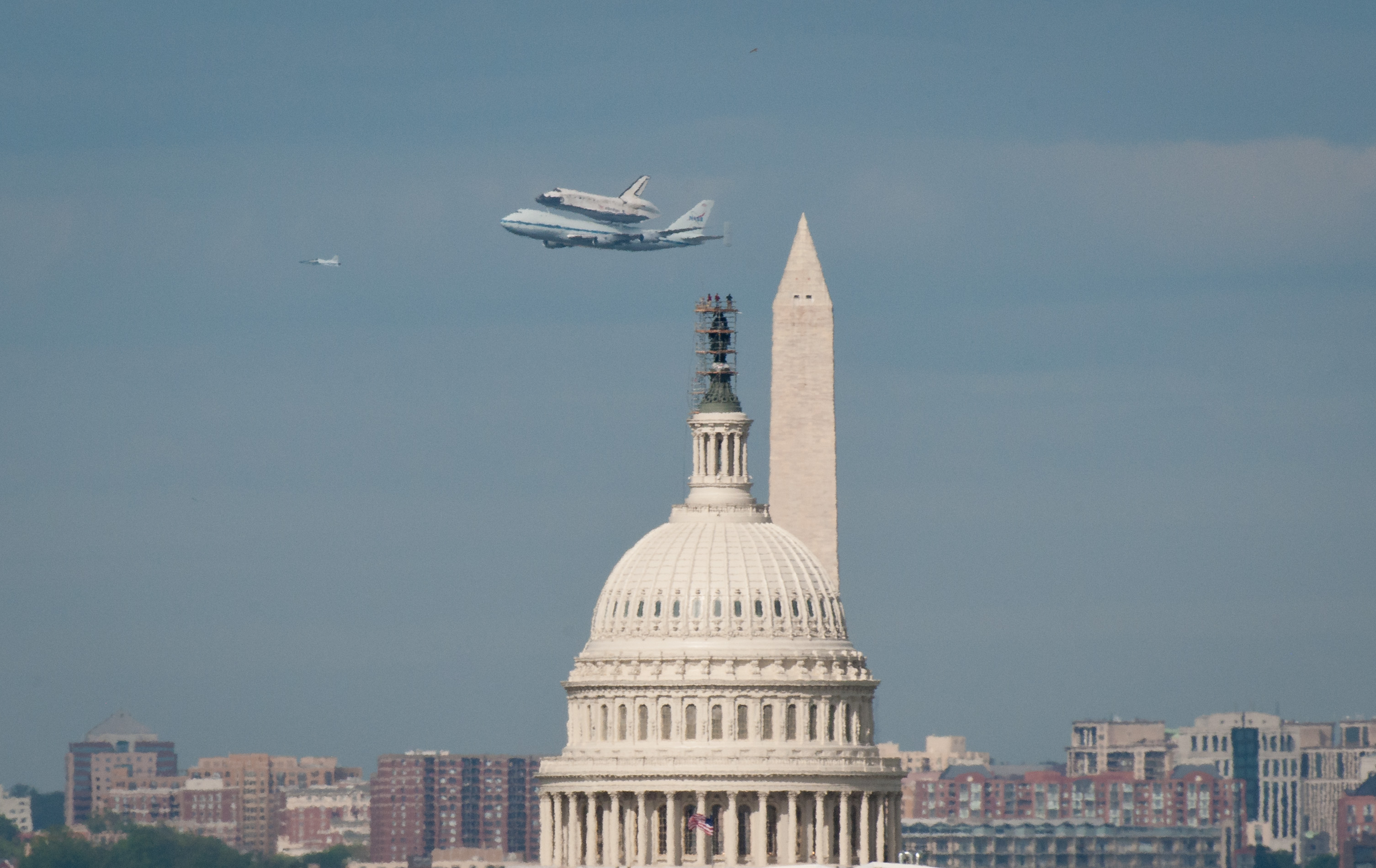 Space Shuttle Discovery over Washington, DC