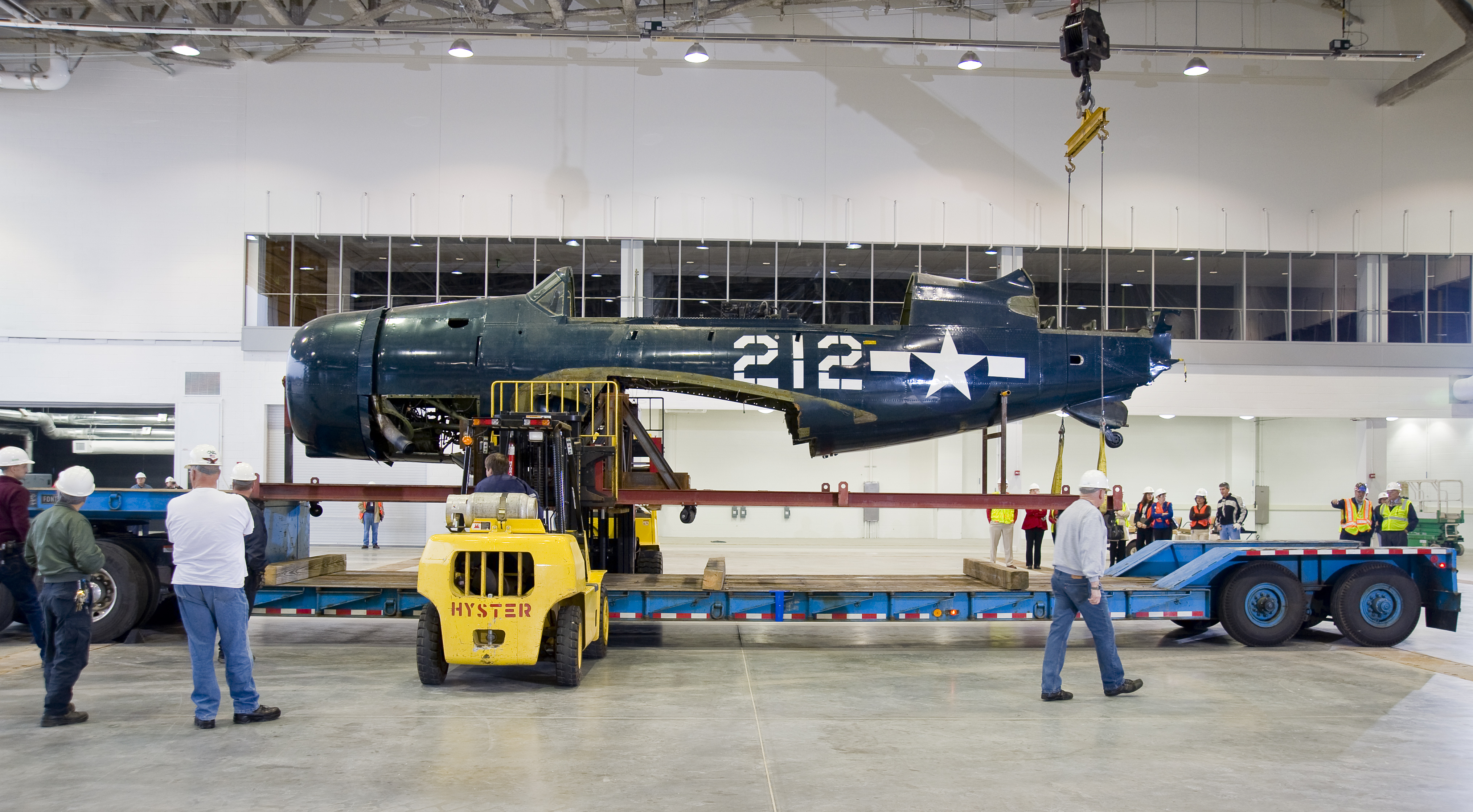 Staff Move Helldiver into Mary Baker Engen Restoration Hangar
