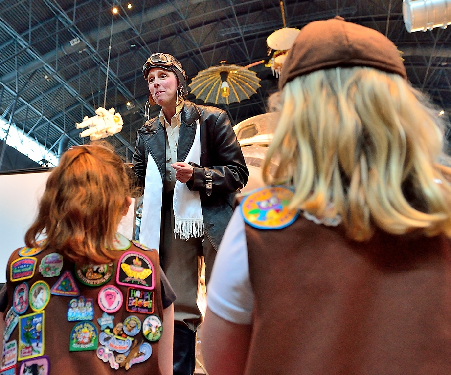 Costumed character talks to girls at family day event