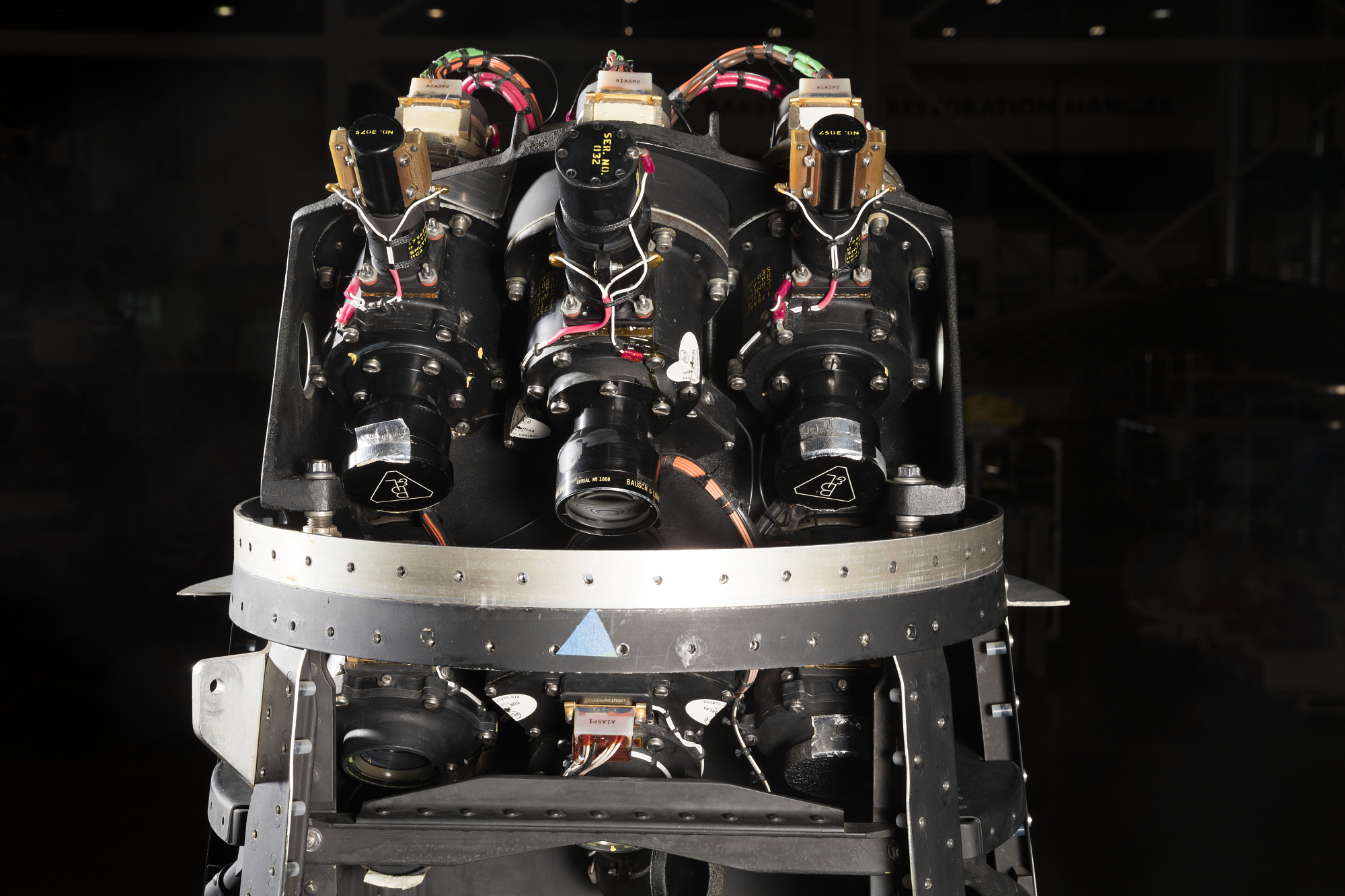 Three camera lenses on top portion of black Ranger spacecraft