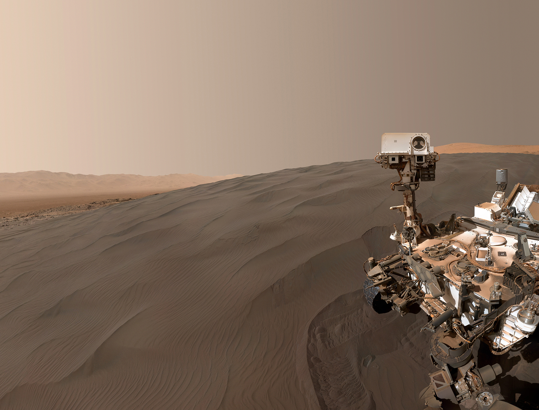 Mars Curiosity Rover reeking into frame on surface of Mars