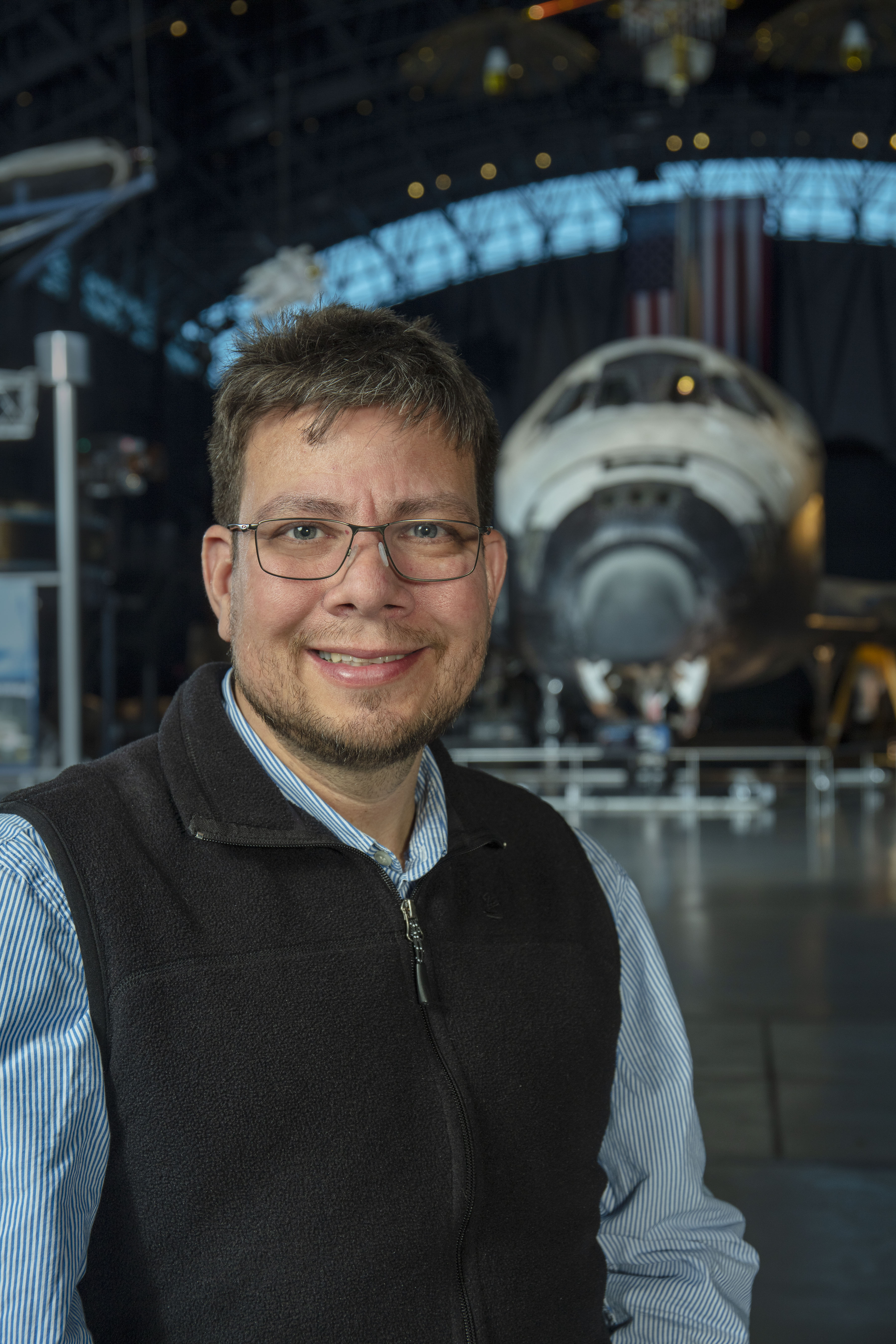 Francisco Torres in front of the space shuttle Discovery