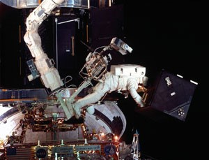 Astronaut working in space.