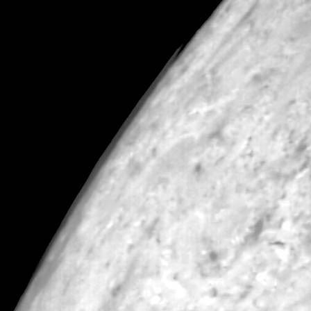 Clouds over Triton's south pole.