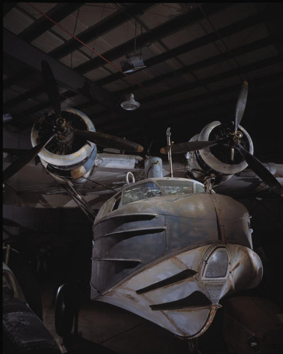 Dramatic photo of the Sikorsky JRS-1 in a hangar.
