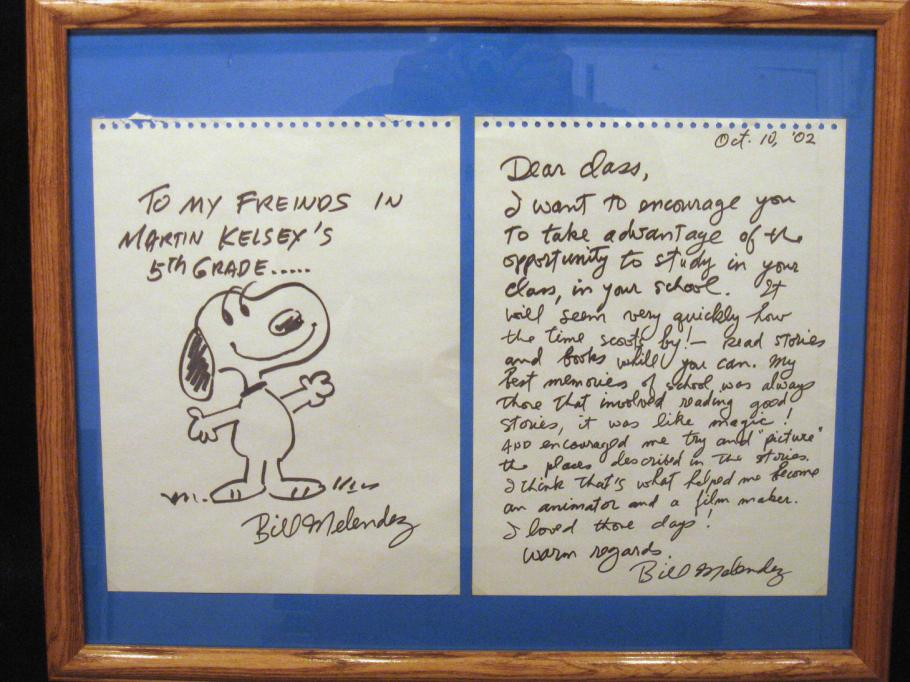 A framed letter with a drawing of Snoopy.