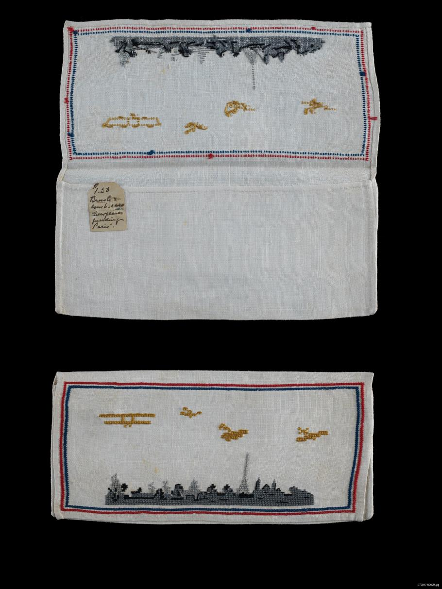 Airplanes embroidered on a linen bag.