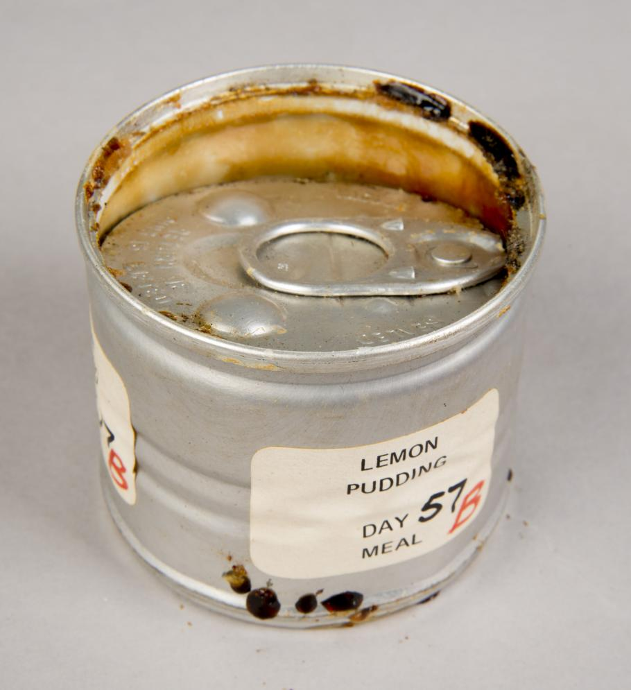 Can of lemon pudding with detaching lid, before treatment
