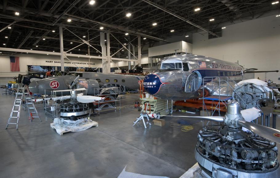 Three aircraft in restoration hangar