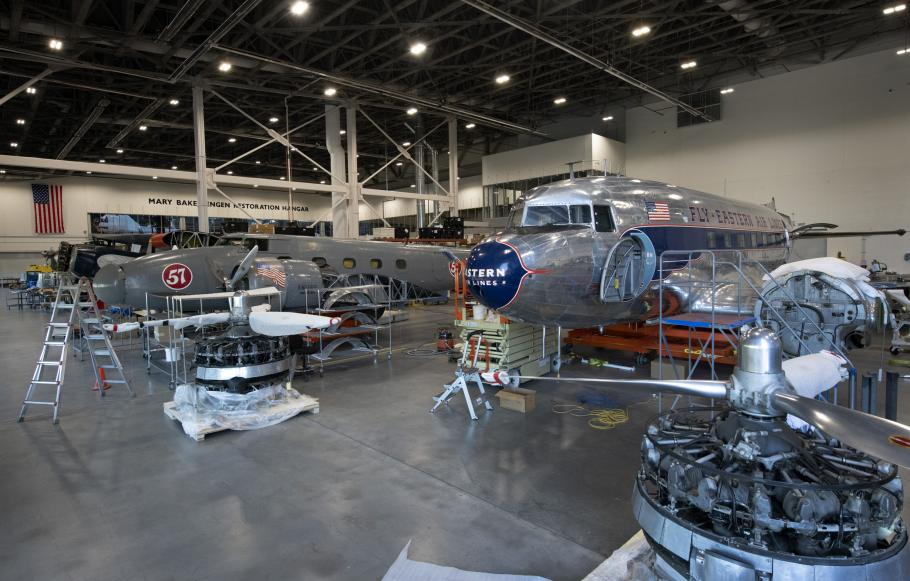 Three aircraft in restoration hangar