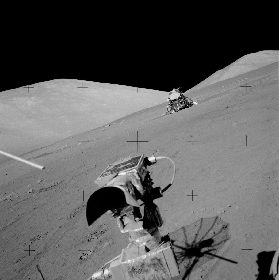 The arrow points to the rock on the lunar surface from which touchable samples were cut.