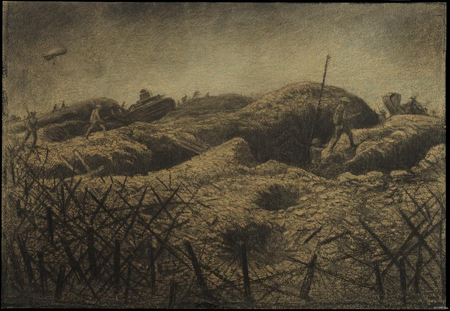 Soldiers walk on top of trenches, barbwire is in the foreground.