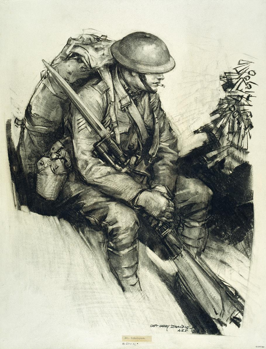 Soldier sits with pack on back and rifle in hand.