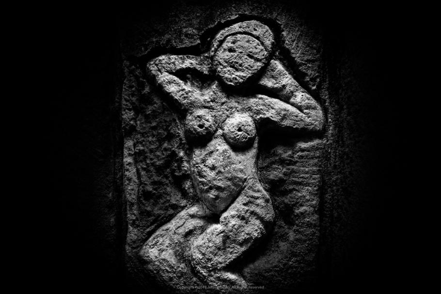Figure of a woman engraved on stone.