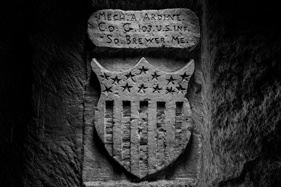 Engraving in stone of stars and stripe emblem.