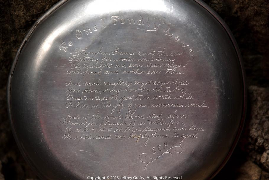 Close up of an engraved mess kit.