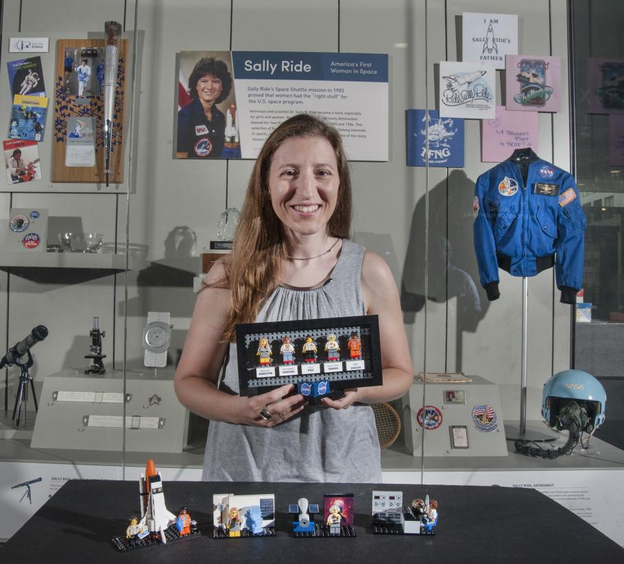 Maia Weinstock with her LEGO® set in front of a Sally Ride display case at the Smithsonian's National Air and Space Museum in Washington DC.
