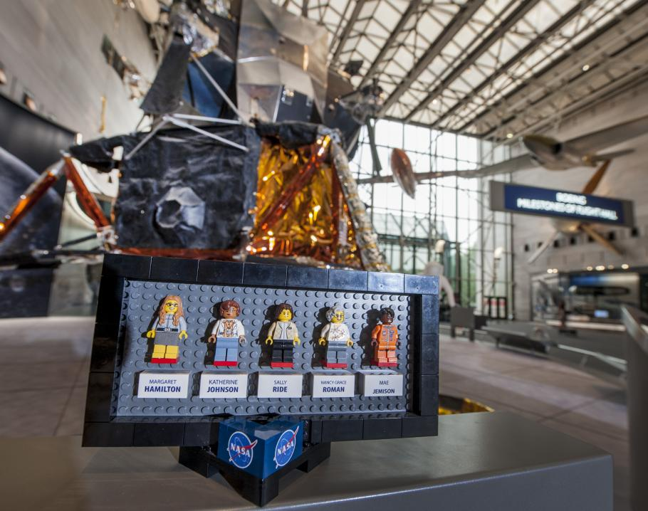 """The original prototypes of the LEGO® Ideas """"Women of NASA"""" set displayed in front of the Apollo Lunar Module in the Boeing Milestones of Flight Hall"""