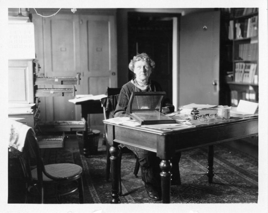 Black and white photo of Cannon at her desk.