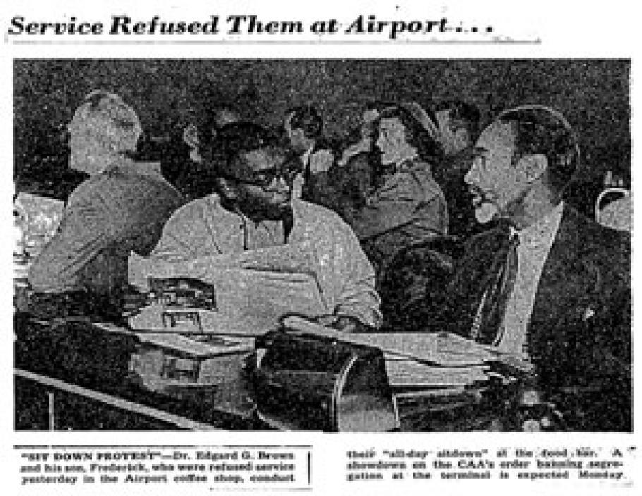 Newspaper clipping with black and white photo of two men sitting at a food counter.