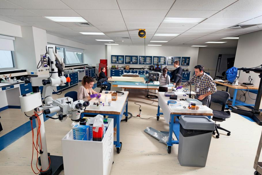 Two conservators work in the lab.