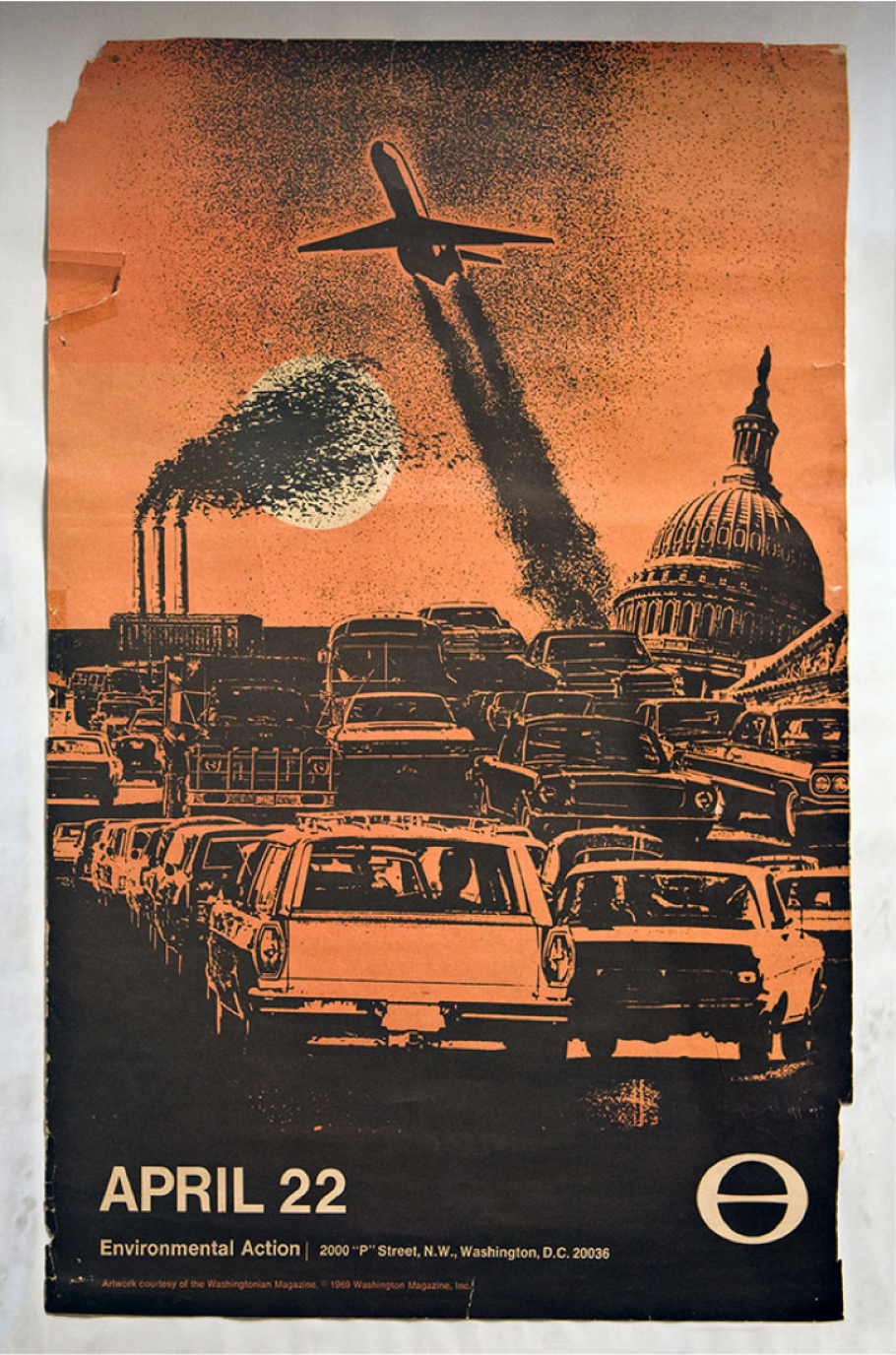 Orange poster featuring traffic and smog.