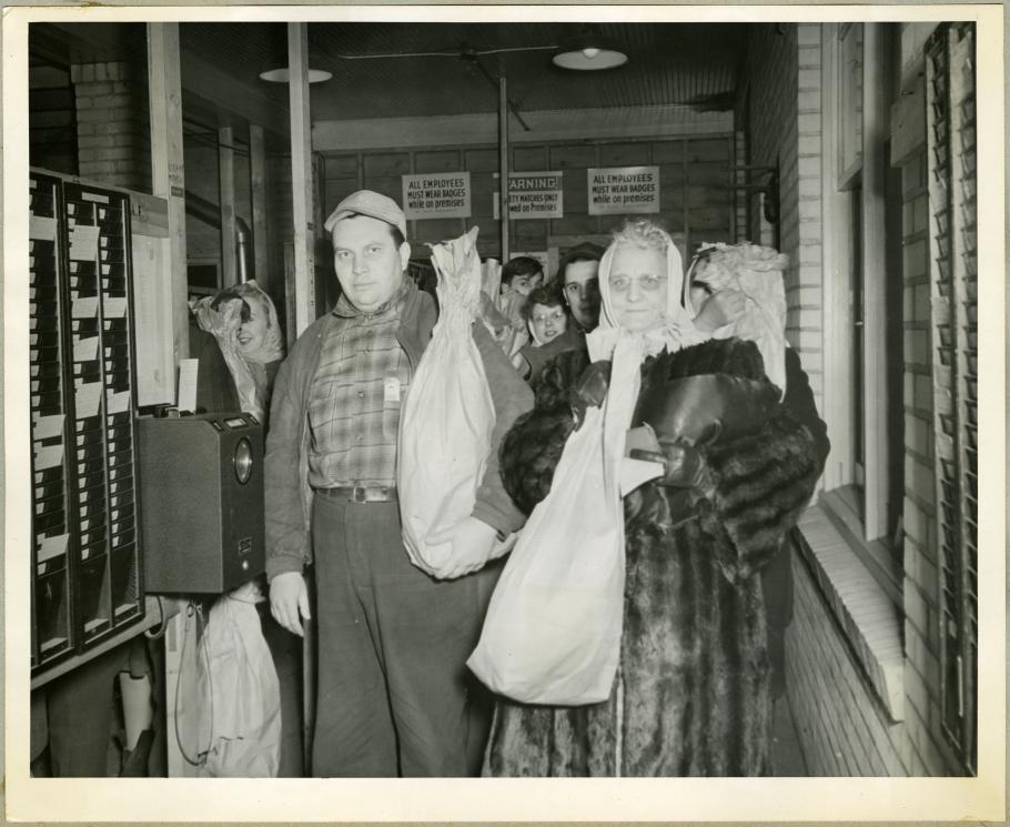 Employees Display Their Bagged Turkeys