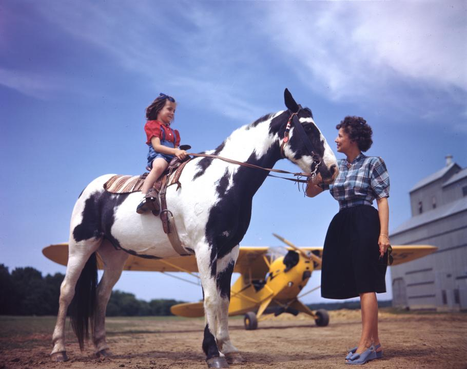 A girl, her pony, and a Piper J-3C Cub