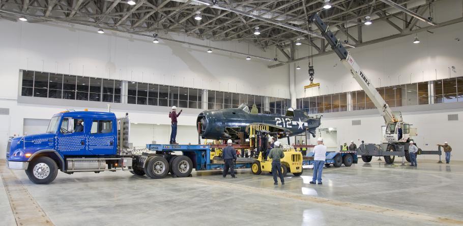 Staff Move <i>Helldiver</i> into Mary Baker Engen Restoration Hangar