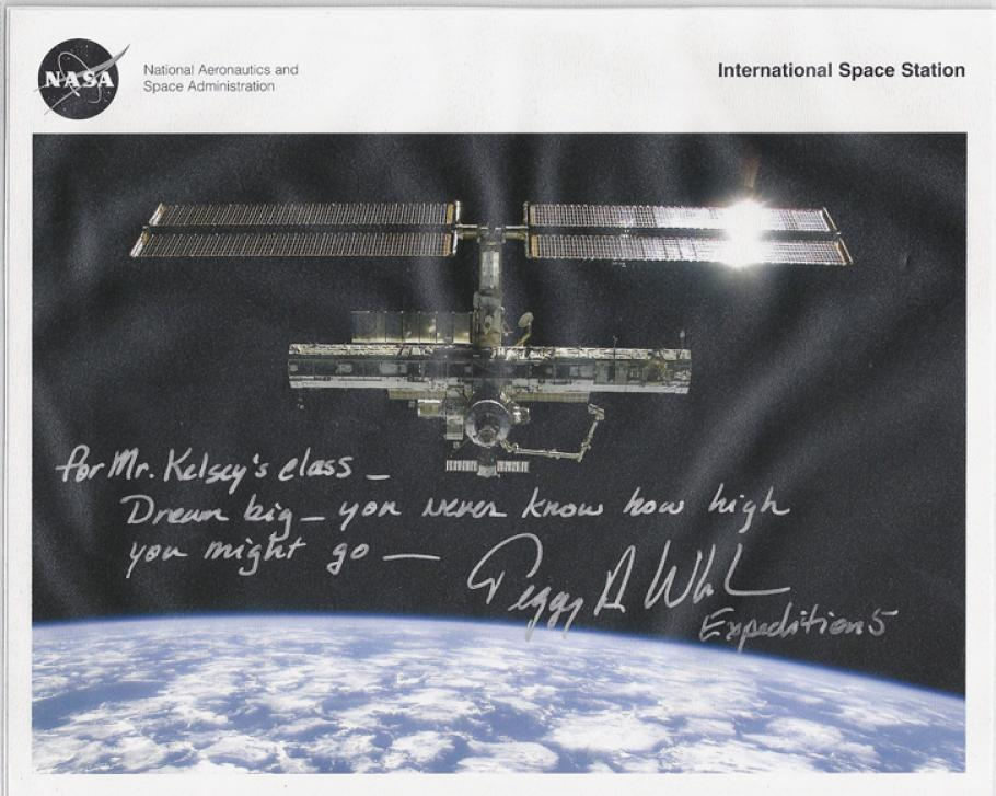 An image of the ISS with a note scrawled on top.