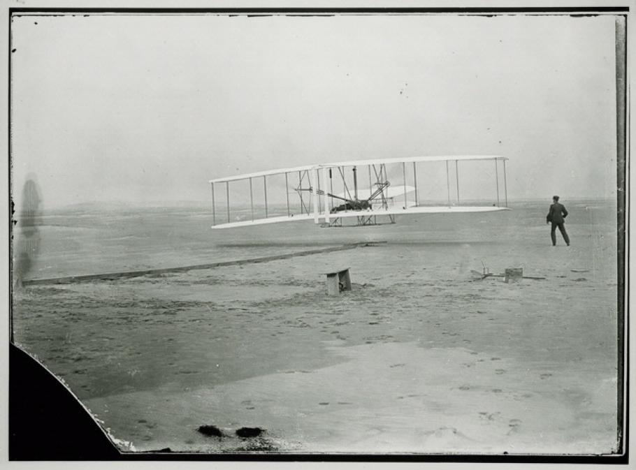 Black and white photo of 1903 Wright Flyer First Flight, Kitty Hawk, N.C.