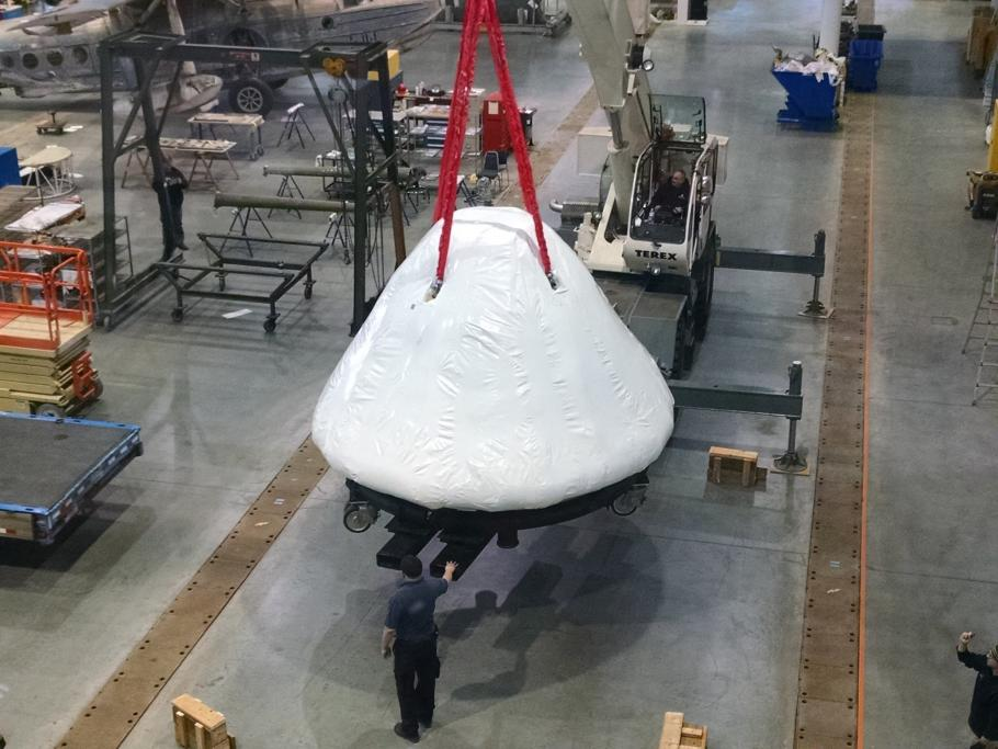 Command module being lifted by crane into the Udvar-Hazy Center.