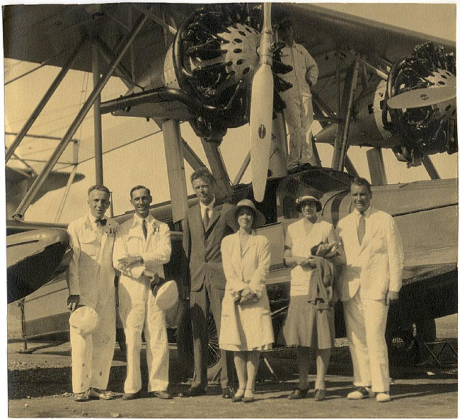 Photo of Charles and Anne Lindbergh with Betty and Juan Trippe and Pan American Airways personnel by a PAA S-38 amphibian.