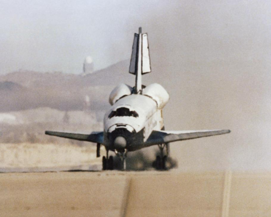 The Space Shuttle Columbia touches down on the runway at Edwards Air Force Base, Calif., to conclude the first orbital shuttle mission, 1981.