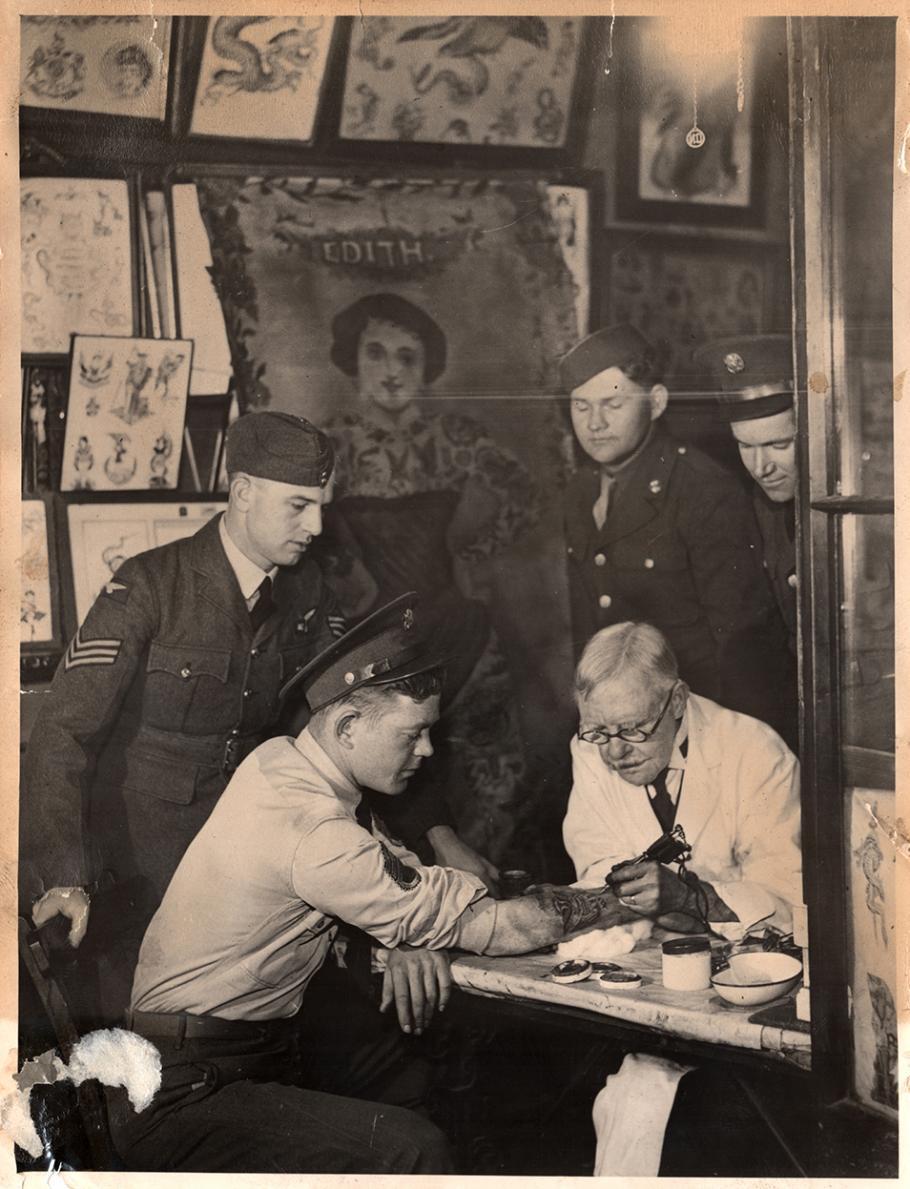 """U.S. soldiers visit tattoo artist George Burchett, known as the """"King of Tattooists"""" in London."""
