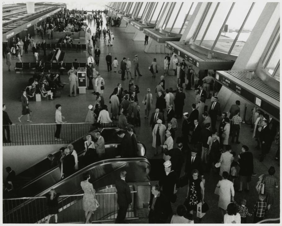 Travelers in the main departures terminal.