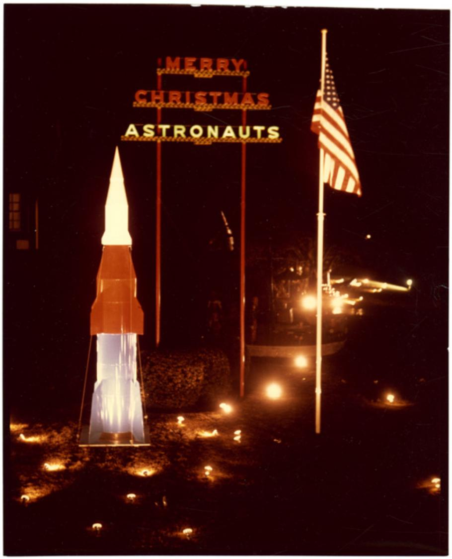 "Rocket, flag and sign saying ""Merry Christmas Astronauts\"""