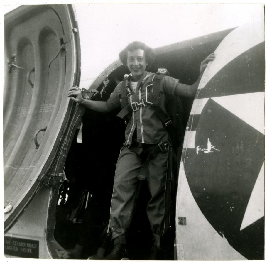 View of Helen G. James posed inside the main cargo door of a Douglas C-47 Skytrain.