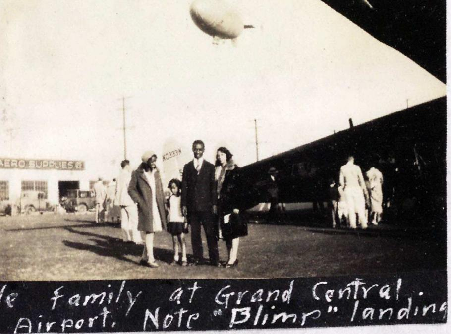 Family standing in front of airplane