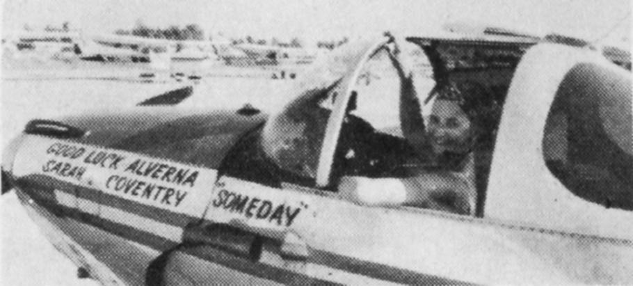 """Black and white image of a woman in the cockpit of an airplane. Painted text of the side of the airplane reads: """"[first line on left] Good luck Alverna [Second line on left] Sarah Coventry [centered line on right] Someday"""""""