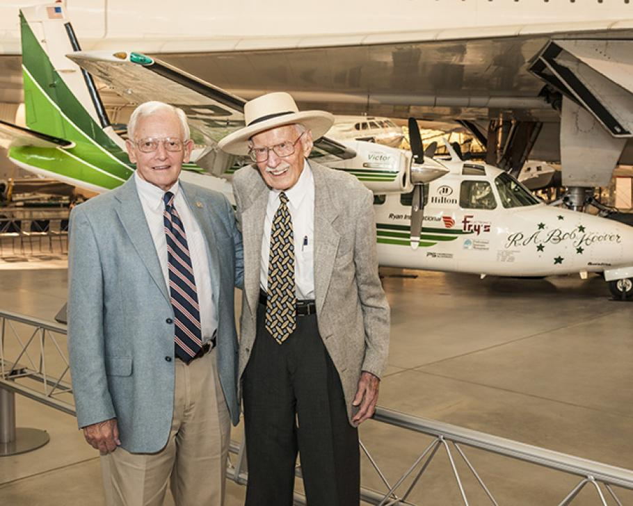 The Museum's director and famed pilot stand beside Hoover's green and white Shrike Commander.