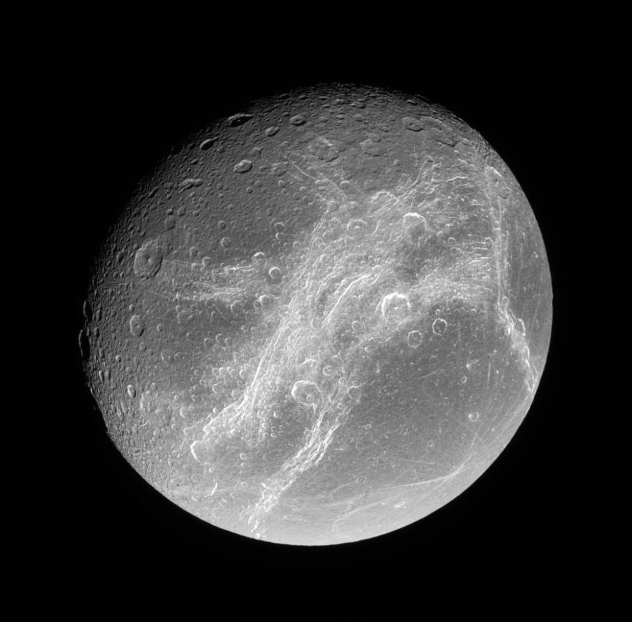 Saturn's moon Dione. Visible are Dione's wispy terrains, which scientists believe formed recently. Linear Virgae are found to the east and west of the wispy terrains.