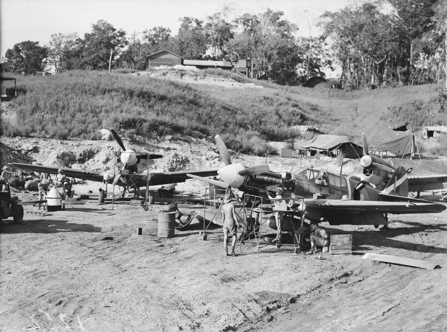 Ground crew servicing a group of Curtiss P-40 Kittyhawks