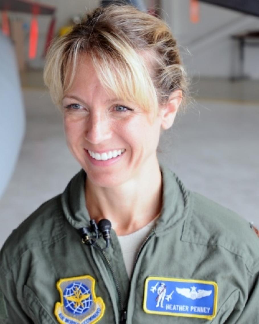PilotHeather Penney, wearing a flight suit.