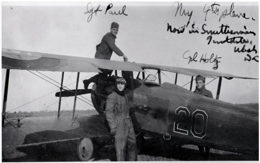 Three men with a biplane